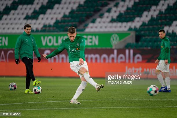 Moenchengladbach's German defender Matthias Ginter warms up prior the German first division Bundesliga football match VfL Wolfsburg v Borussia...