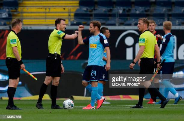 Moenchengladbach's German defender Tony Jantschke greets the referees after the German first division Bundesliga football match Eintracht Frankfurt v...