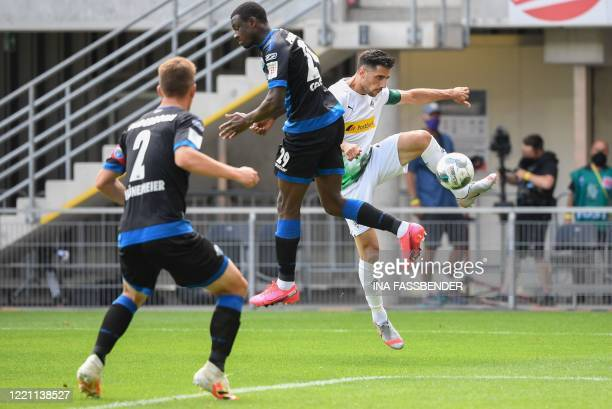Moenchengladbach's German forward Lars Stindl and Paderborn's Nigerian defender Jamillu Collins vie for the ball during the German first division...