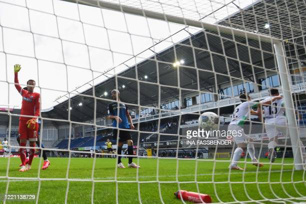 Moenchengladbach's German forward Lars Stindl celebrates scoring past Paderborn's German goalkeeper Leopold Zingerle during the German first division...