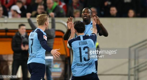 Moenchengladbach's German forward Lars Stindl celebrates scoring the 12 goal with Moenchengladbach's French forward Marcus Thuram and...