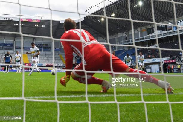 Moenchengladbach's German forward Lars Stindl scores from the penalty spot past Paderborn's German goalkeeper Leopold Zingerle during the German...