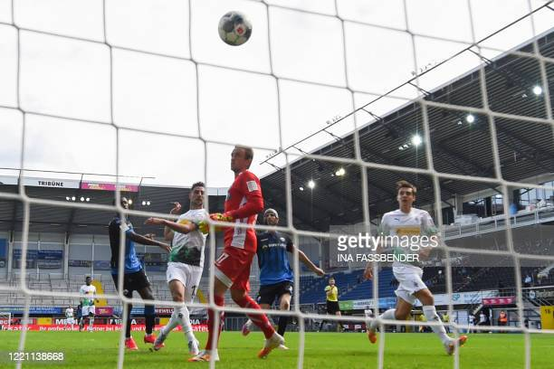 Moenchengladbach's German forward Lars Stindl scores past Paderborn's German goalkeeper Leopold Zingerle during the German first division Bundesliga...