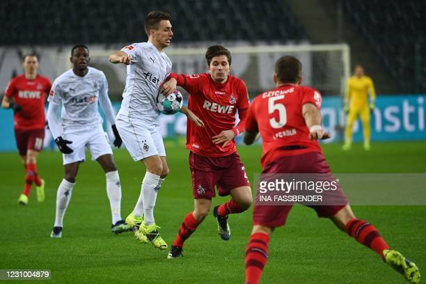Moenchengladbach's German forward Patrick Herrmann and Cologne's German midfielder Elvis Rexhbecaj vie for the ball during the German first division...
