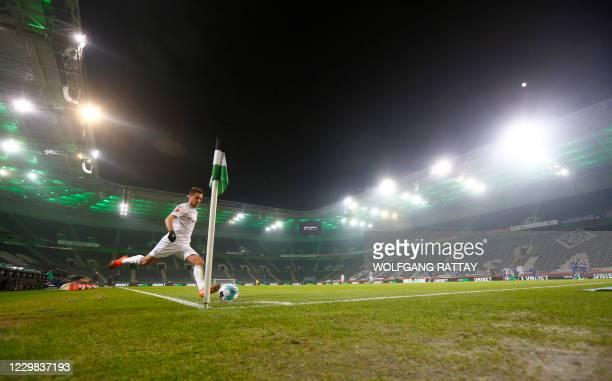 Moenchengladbach's German forward Patrick Herrmann takes a corner during the German first division Bundesliga football match Borussia...