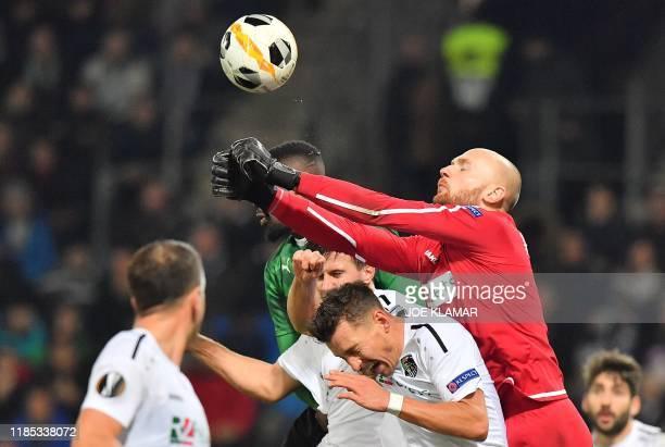 Moenchengladbach's German goalkeeper Max Gruen saves the ball during the Europa League football match between Wolfsberg RZ Pellets WAC and Borussia...
