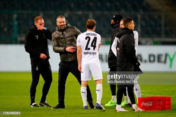 Moenchengladbach's German head coach Marco Rose celebrates with Moenchengladbach's German defender Tony Jantschke after winning the German first...