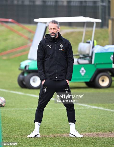 Moenchengladbach's German head coach Marco Rose watches his players during a training session on the eve of the UEFA Champions League, last 16,...