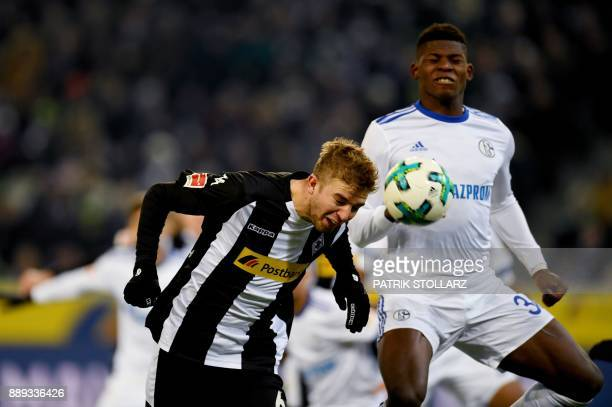 Moenchengladbach's German midfielder Christoph Kramer and Schalke's Swiss forward Breel Embolo vie for the ball during the German first division...
