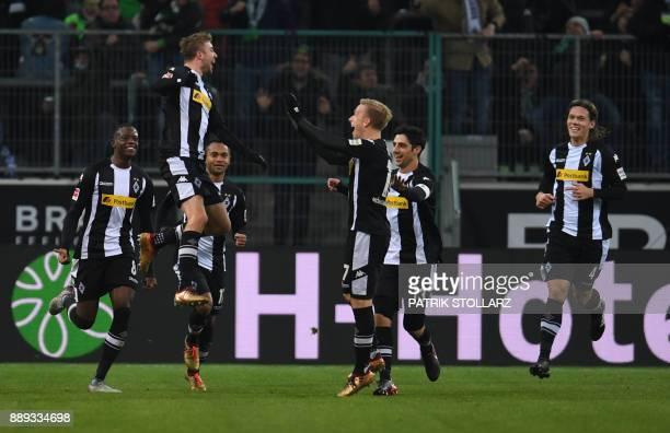Moenchengladbach's German midfielder Christoph Kramer celebrates with teammates after scoring during the German first division Bundesliga football...