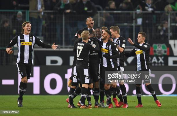 Moenchengladbach's German midfielder Christoph Kramer is congratulates by teammates after scoring during the German first division Bundesliga...