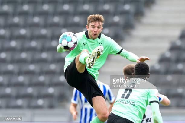Moenchengladbach's German midfielder Christoph Kramer jumps for the ball during the German first division Bundesliga football match between Hertha...