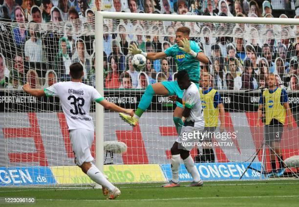 Moenchengladbach's German midfielder Florian Neuhaus and Moenchengladbach's German midfielder Florian Neuhaus vie with Hertha Berlin's German...