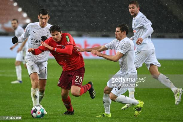 Moenchengladbach's German midfielder Florian Neuhaus, Cologne's German midfielder Elvis Rexhbecaj and Moenchengladbach's German midfielder Jonas...