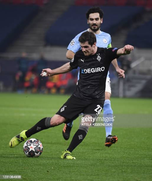 Moenchengladbach's German midfielder Jonas Hofmann and Manchester City's German midfielder Ilkay Gundogan vie for the ball during the UEFA Champions...