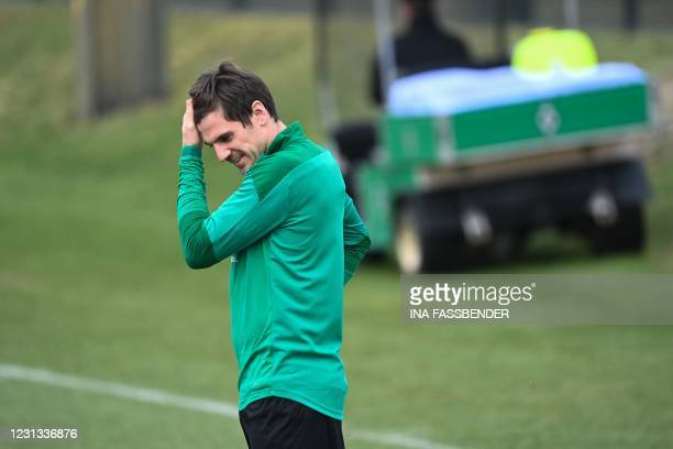 Moenchengladbach's German midfielder Jonas Hofmann takes part in a training session on the eve of the UEFA Champions League, last 16, first-leg...