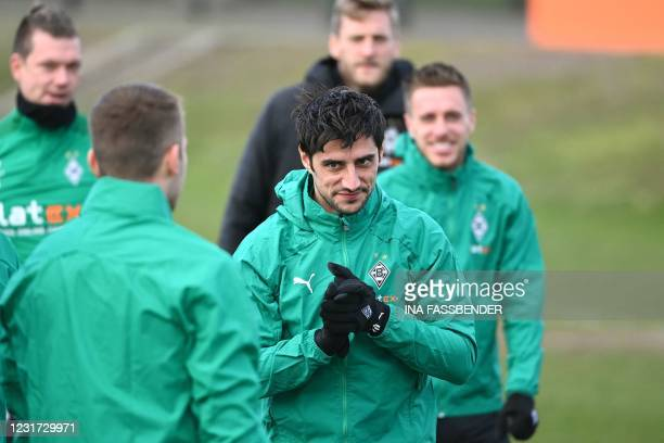 Moenchengladbach's German midfielder Lars Stindl and Moenchengladbach's German forward Patrick Herrmann take part in a training session in...