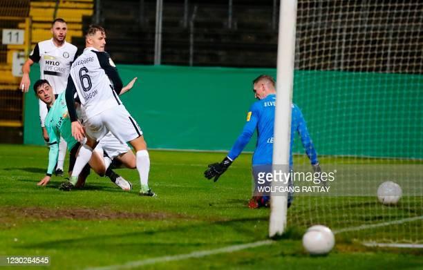 Moenchengladbach's German midfielder Lars Stindl scores during the German Cup 2nd round football match SV Elversberg v Borussia Moenchengladbach, in...