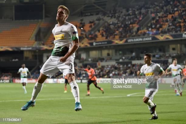 Moenchengladbach's German midfielder Patrick Herrmann celebrates after scoring a goal during the UEFA Europa League Group J football match between...