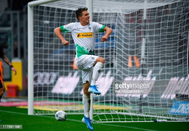 Moenchengladbach's German midfielder Patrick Herrmann celebrates after scoring the 20 goal during the German first division Bundesliga football match...
