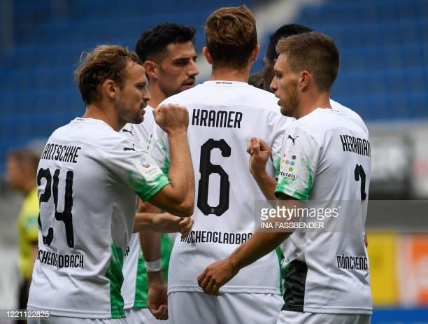 Moenchengladbach's German midfielder Patrick Herrmann celebrates scoring the opening goal with his teammate Moenchengladbach's German defender Tony...