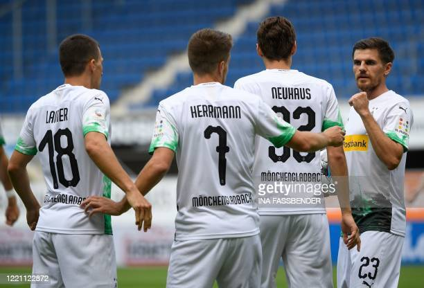 Moenchengladbach's German midfielder Patrick Herrmann celebrates scoring the opening goal with his teammates during the German first division...