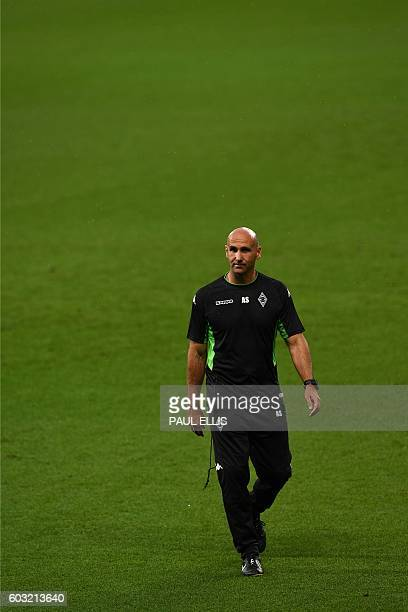 Moenchengladbach's head coach André Schubert attends a training session at the Etihad Stadium in Manchester, north west England on September 12, 2016...