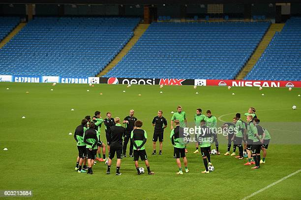 Moenchengladbach's head coach André Schubert leads a training session at the Etihad Stadium in Manchester, north west England on September 12, 2016...