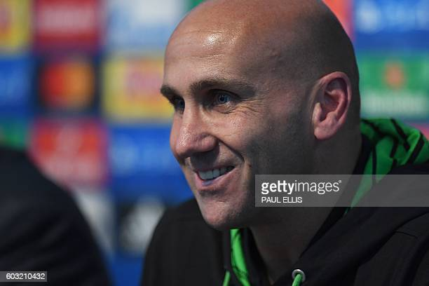 Moenchengladbach's head coach André Schubert speaks during a press conference at the Etihad Stadium in Manchester, north west England on September...