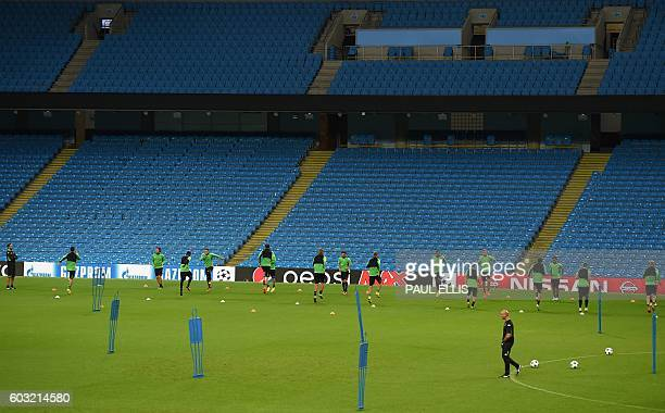 Moenchengladbach's head coach André Schubert watches his players during a training session at the Etihad Stadium in Manchester, north west England on...