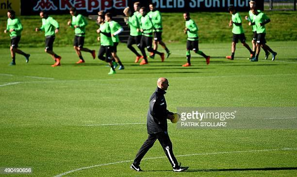 Moenchengladbach's head coach Andre Schubert attends a training session on the eve of the Group D, first-leg UEFA Champions League football match...