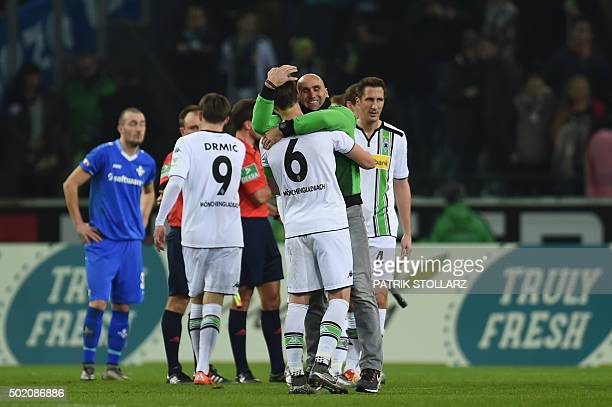 Moenchengladbach's head coach Andre Schubert celebrates with his players after the German first division Bundesliga football match Borussia...