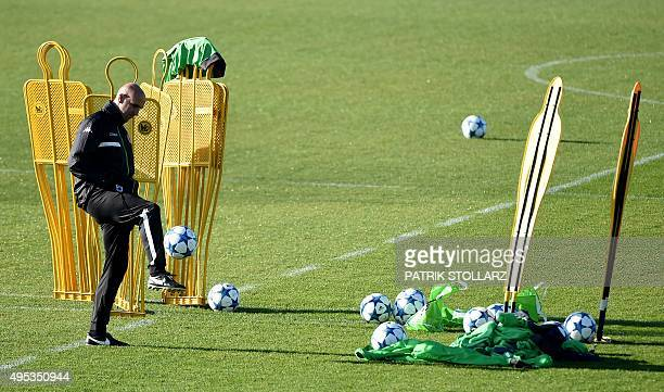 Moenchengladbach's head coach Andre Schubert plays the ball during a training session on the eve of the Group D, second-leg UEFA Champions League...