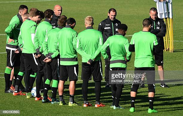 Moenchengladbach's head coach Andre Schubert talks to the players during a training session on the eve of the Group D, first-leg UEFA Champions...