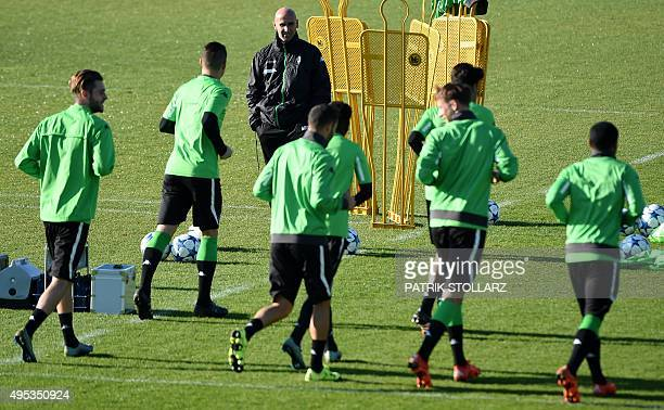 Moenchengladbach's head coach Andre Schubert watches his players during a training session on the eve of the Group D, second-leg UEFA Champions...