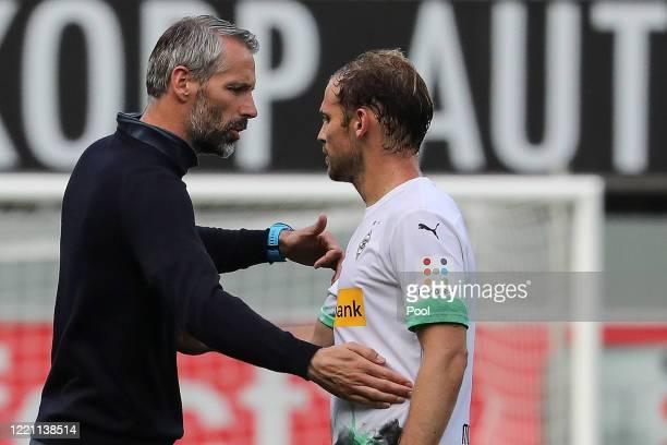 Moenchengladbach's head coach Marco Rose hugs Moenchengladbach's Tony Jantschke after the Bundesliga match between SC Paderborn 07 and Borussia...