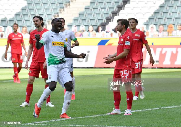 Moenchengladbach's Marcus Thuram front left celebrates after scoring his side's second goal during the Bundesliga match between Borussia...