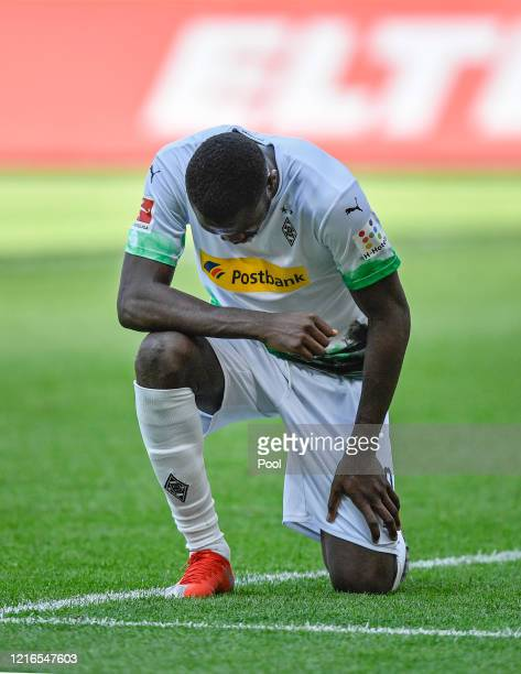 Moenchengladbach's Marcus Thuram reacts after scoring his side's second goal during the Bundesliga match between Borussia Moenchengladbach and 1 FC...