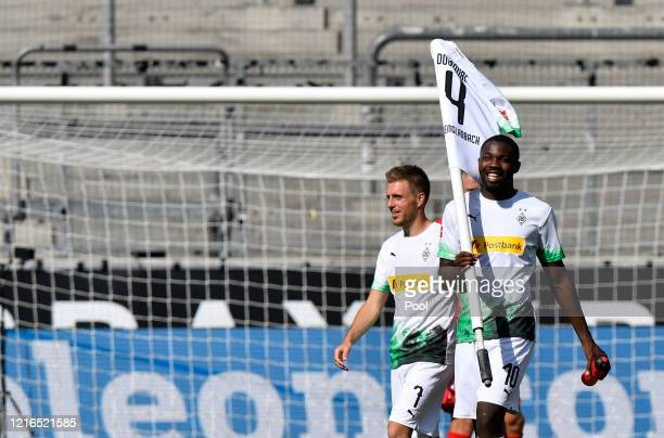 Moenchengladbach's Marcus Thuram right celebrates with Moenchengladbach's Patrick Herrmann after the Bundesliga match between Borussia...