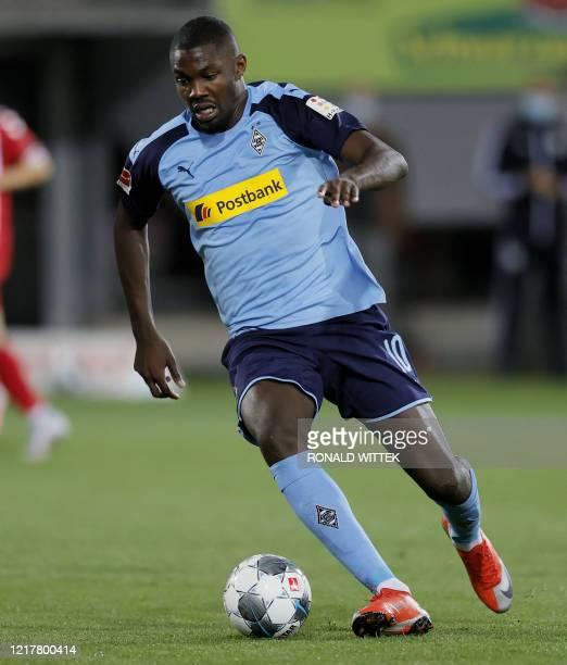 Moenchengladbach's Marcus Thuram runs with the ball during the German first division Bundesliga football match SC Freiburg v Borussia...