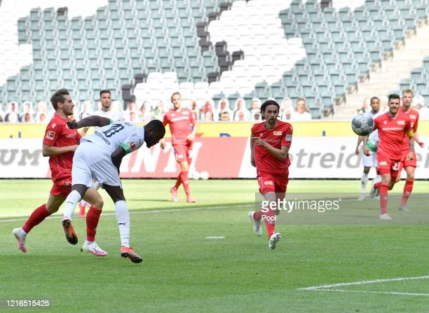 Moenchengladbach's Marcus Thuram second left scores his side's second goal during the Bundesliga match between Borussia Moenchengladbach and 1 FC...