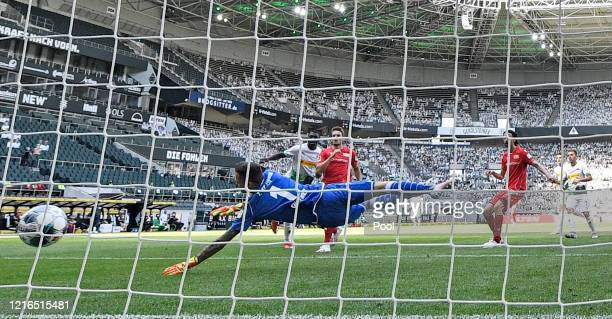 Moenchengladbach's Marcus Thuram second left scores his side's second goal against Berlin keeper Rafal Gikiewicz during the Bundesliga match between...