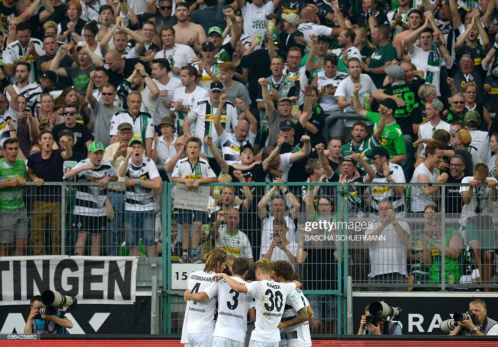 Moenchengladbach's midfielder Lars Stindl celebrates scoring the 2:1 with his teammates during the German first division Bundesliga football match of Borussia Moenchengladbach vs Bayer 04 Leverkusen in Moenchengladbach, western Germany, on August 27, 2016. / AFP / SASCHA