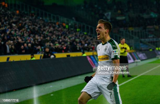 Moenchengladbach's midfielder Patrick Herrmann celebrates his 20 goal during the German first division Bundesliga football match Borussia...