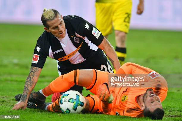 Moenchengladbach's Paraguayan forward Raul Bobadilla looks after Dortmund's Swiss goalkeeper Roman Buerki during the German first division Bundesliga...