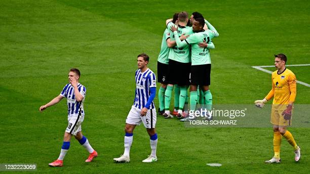 Moenchengladbach's players celebrate after German midfielder Lars Stindl scored the 2-1 goal during the German first division Bundesliga football...