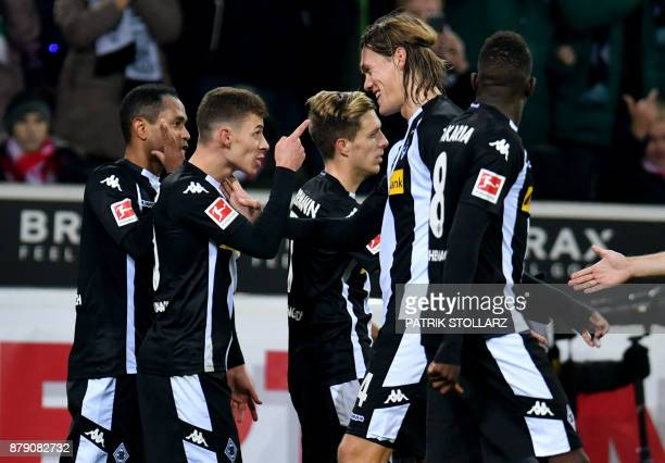 Moenchengladbach's players celebrate after scoring a goal during the German First division Bundesliga football match Borussia Moenchengladbach vs...