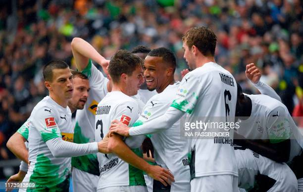Moenchengladbach's players celebrate after scoring the 30 goal during the German first division Bundesliga football match Borussia Moenchengladbach...