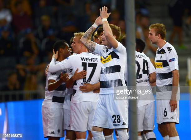 Moenchengladbach's players Ramos Oscar Wendt Andre Hahn Tony Jantschke and Christoph Kramer celebrates the 13 at UEFA Champions League playoff first...