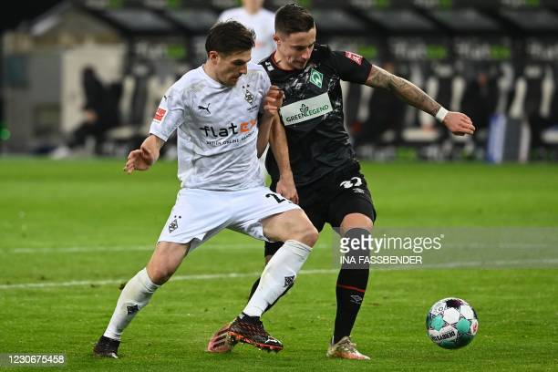 Moenchengladbach's Slovakian midfielder Laszlo Benes and Bremen's Austrian forward Marco Friedl vie for the ball during the German first division...